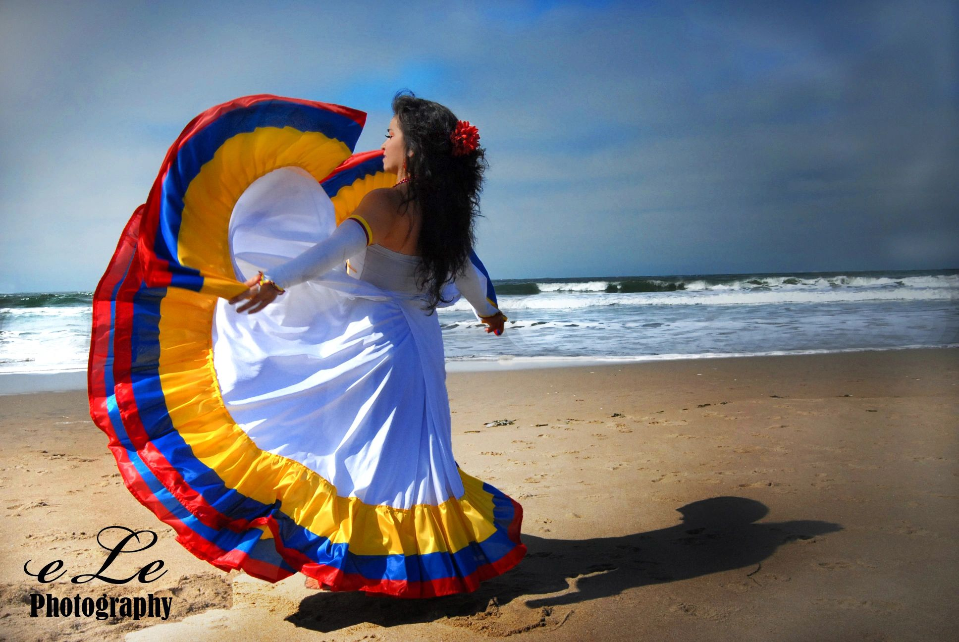 Adriana waving a traditional Colombian skirt at the Ocean Beach in San Francisco, California. USA.