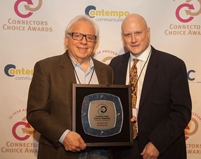 Dr. Mike Vacante and Gary Naherny of the Mike Petrone Band receiving an award in 2016.