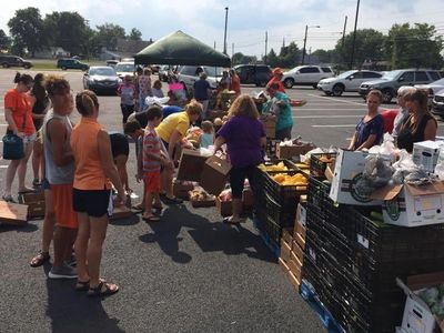 "Crosspoiont Church volunteers serving at a ""Produce Only"" mobile Food Pantry!"
