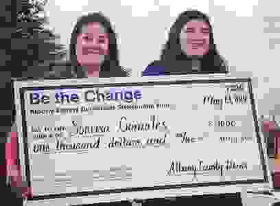 Sonrisa Gonzales (right) with her mother accepting the $1000 scholarship award.