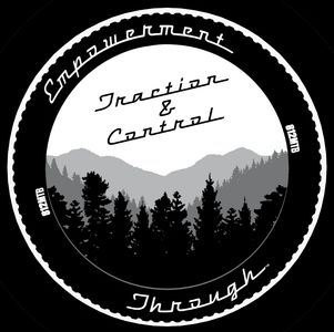 Empowerment through traction and control logo comprised of a tire, mountains and trees.