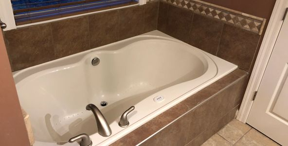 Large air jetted Jacuzzi in Master Bedroom Bathroom at The Reserve Luxury Sober Living for Women