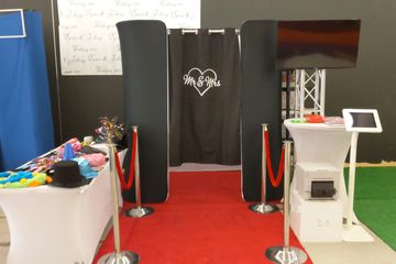 "alt=""Black curtain that says 'Mr & Mrs' on a red carpet at Fotoboyz.boston West Bridgewater Office"""