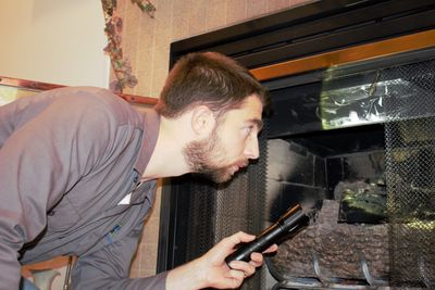 Inspector Andy Inspecting a Fireplace