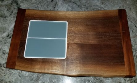 Green Glass Subway tile embedded into live edge walnut.