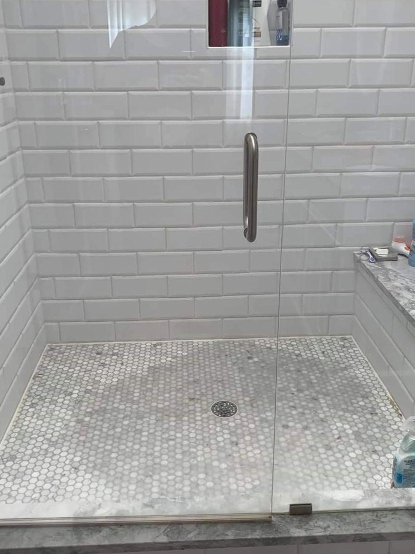 carrara marble tile discoloration on