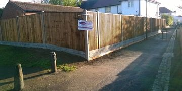 Close boarded fencing with concrete post and gravel boards