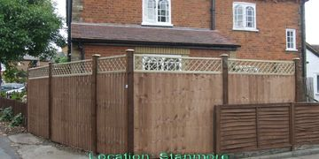 panel fencing with wooden post and trellis