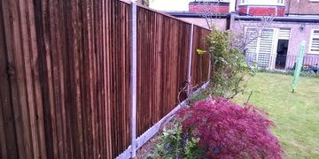 Close boarded fencing with concrete post and concrete gravel boards