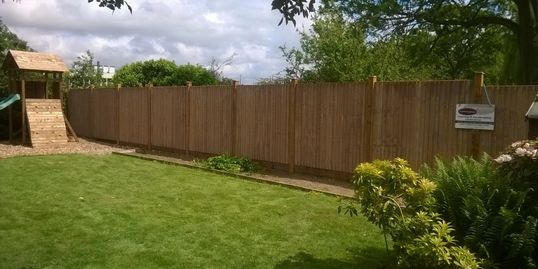 Close boarded style with wooden post and wooden gravel boards