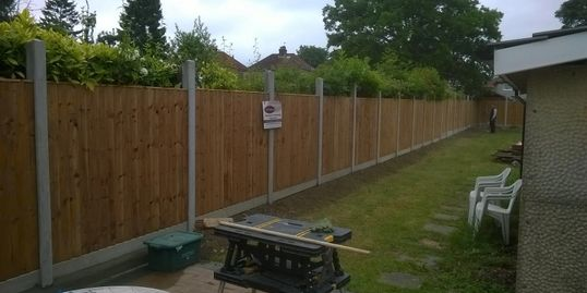 close boarded panel fencing with concrete post and gravel boards at a height of 6""