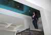 Glazing a turquoise metallic foil ceiling.