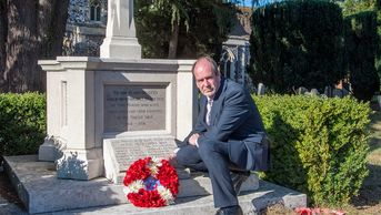 Councillor Tim Barrott laying a wreath, featured in the virtual service.