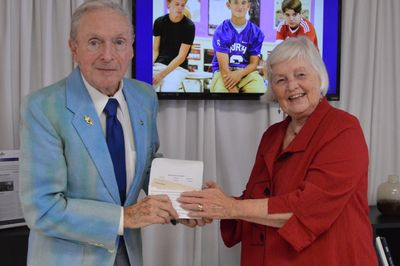 Dr. Floyd Mizener, Class of 1944, presenting donation to Foundation President Julia K. Beckman.