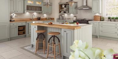Solid oak painted kitchen in alabaster incorporating island with seating.
