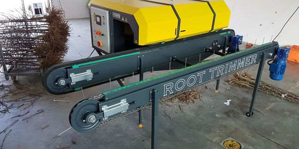 Root Trimmer Machine to cut  tree roots to fit into a container