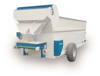 Potting machine for filling large pots, containers or bags with a discharge chute