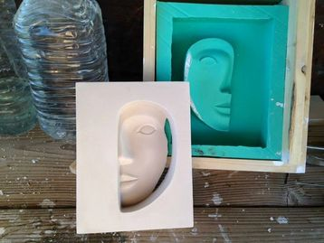 Silicone mold and plaster cast.