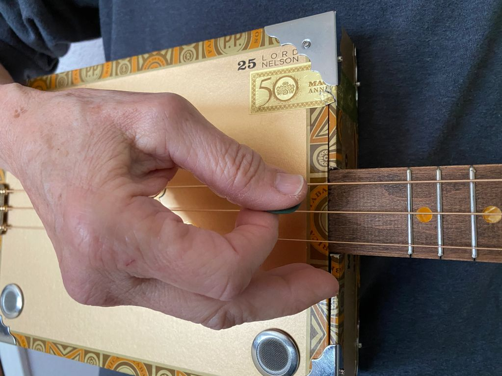 Picking on a 3-String cigar Box Guitar