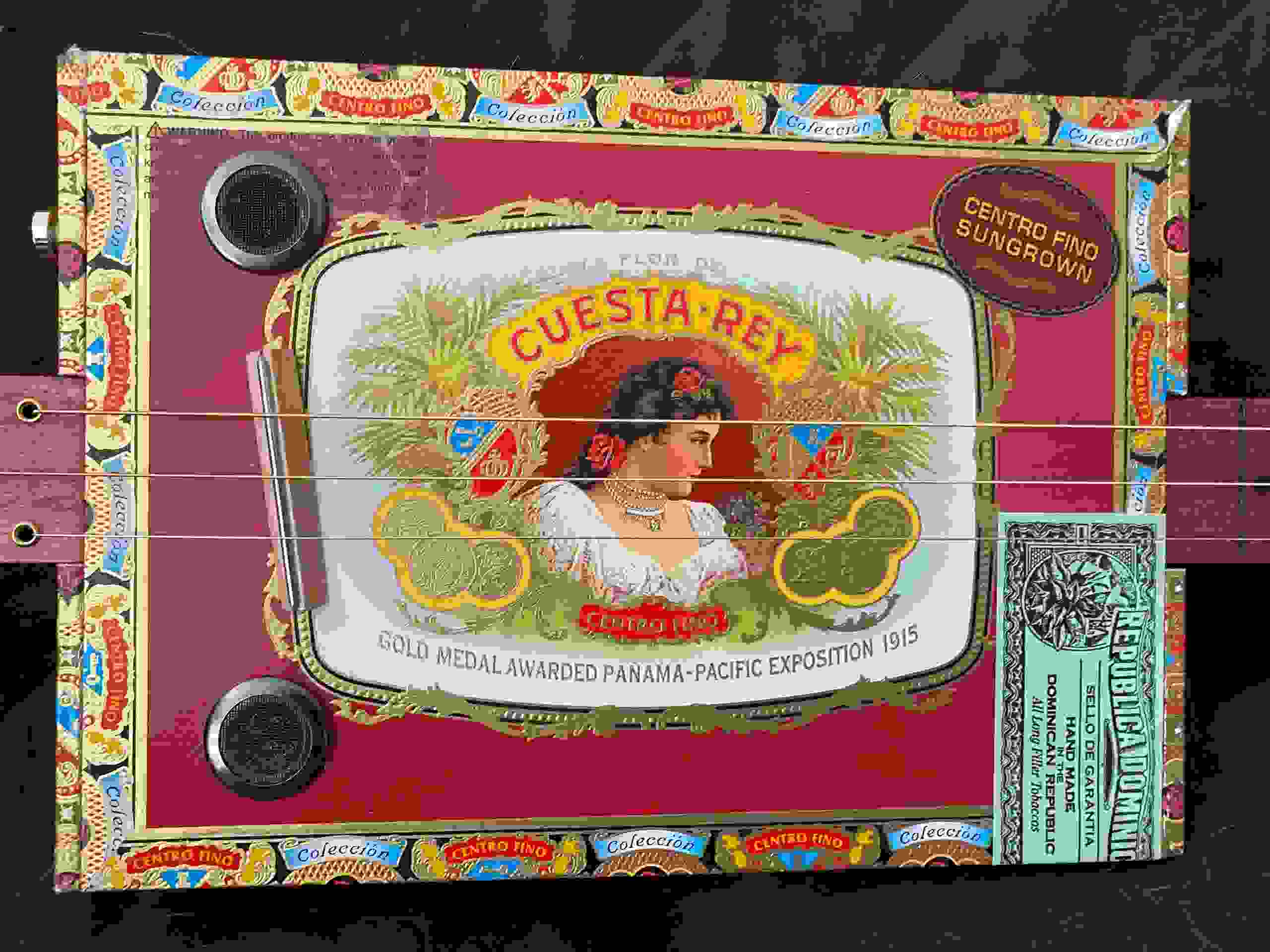 Actual 3-String Fretless Cigar Box Guitar that is featured in this program.