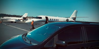 Tour Van in front of private jet