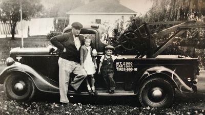 Founder, Lee Wilcox, with his first tow truck