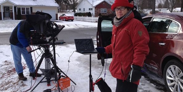 Teleprompter Operator prompting outdoors in snow