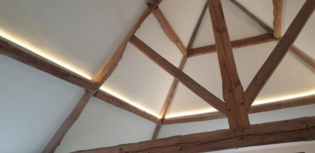 Plastered character property renovation in Dorset. Wooden feature beams & sympathetic plaster finsih