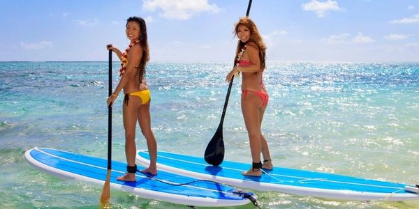 girls paddleboarding with aqua flight watersports, come have fun with the best watersport rental in fort lauderdale beach fun beach jetski beach kayak rentals beach drinks in fort lauderdale  beach boats sundeck renals pontoon rentals in fort lauderdale. flyboaridng with aqua flight watersports.