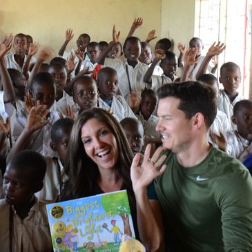 Virtual Hug for the World: Author and Illustrator Amanda Perlyn Jackson sharing books with children in Tanzania (2015).