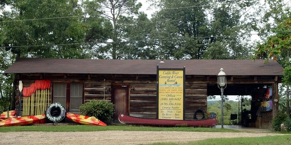 Our old log cabin office at 26 Hwy 8 E Glenwood, AR 71943
