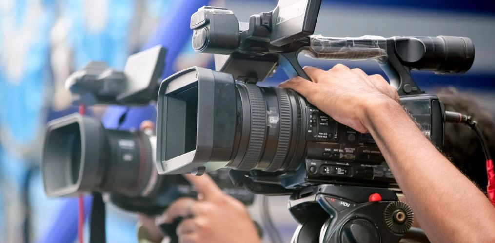 Two Sony prosumer/broadcast Video Cameras, placed side by side. An excellent choice for Weddings.