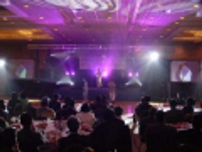 Indoor concert, with real screen video projection. Multiple screens provide viewing from all angles.