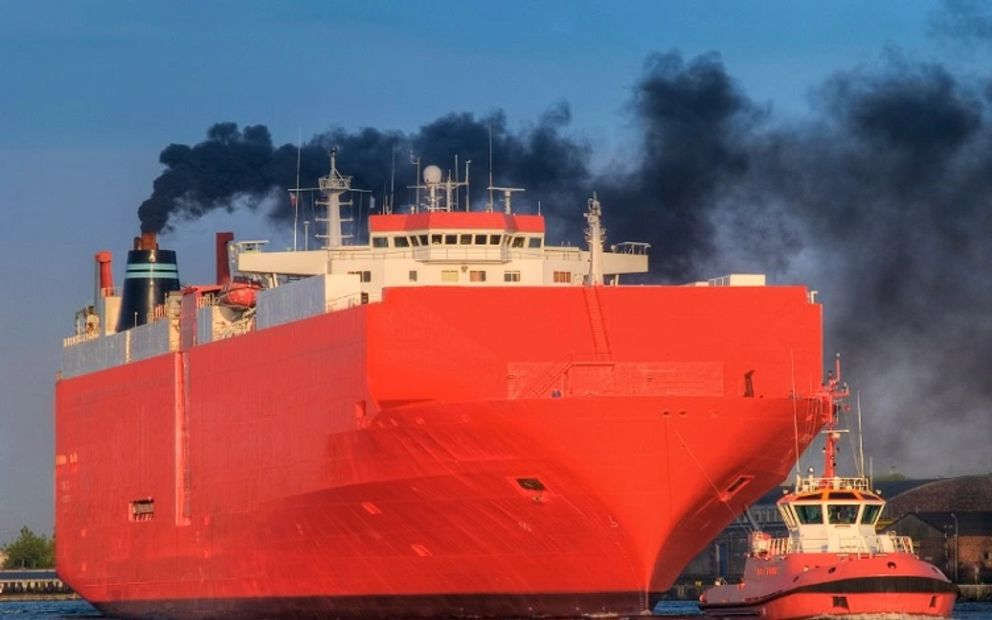 Cargo ship emitting toxic sulfur into the atmosphere.