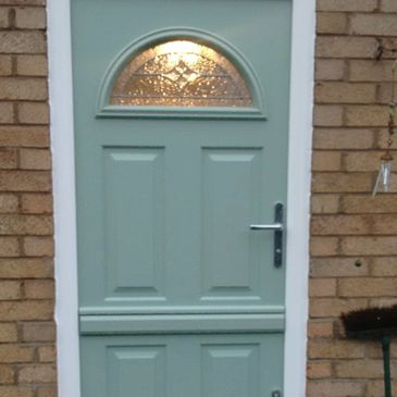 Chartwell Green Solid Core Stable door with Zinc Arr glass fitted by Worksop Composite Doors.