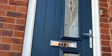 Blue Solid Core composite door with Flair glass fitted by Worksop Composit Doors in Clay Cross.