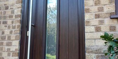 Black Brown Solid Core door with a Long Bar handle & Ultion lock fitted by Worksop Composite Doors.