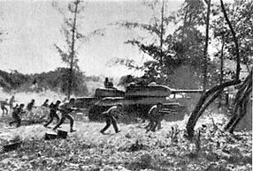 Cuban soldiers supported by T-34 tanks attacking near Playa Giron. 19 April 1961