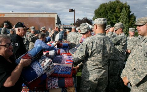 Veteran Advocates of Ore-Ida distributing local handmade quilts to our Troops.