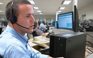 Staff answering the White House VA Hotline. 1-855-948-2311 - service open 24/7