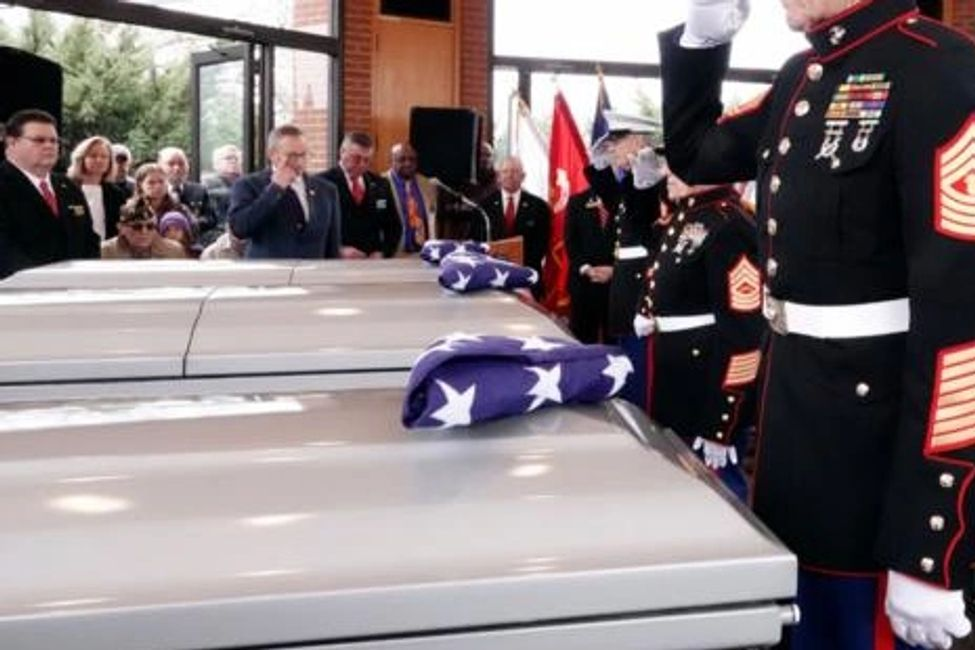 A retired U.S. Marine Corps master gunnery sergeant 'salutes' three unclaimed remains of Veterans.