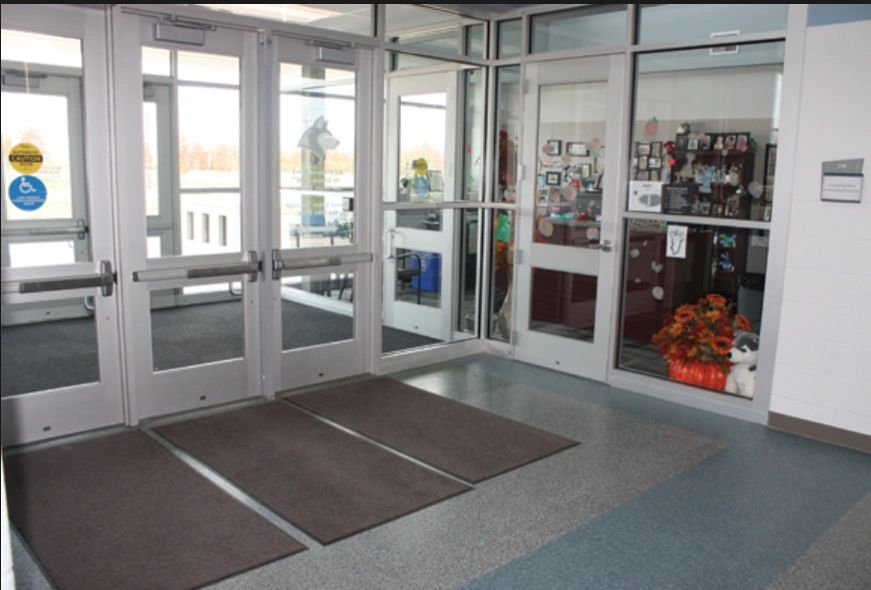 Vestibule design featured with a layered entry system. Visitors have to pass through two doors, each with seperate release.
