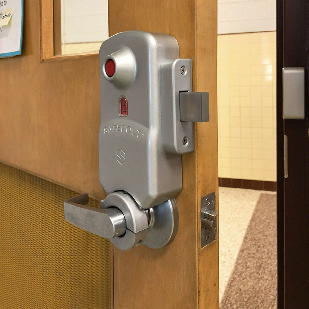 Red Button Locks like the SAFEBOLT™ are equipped with visual indicators on the classroom side of the doors to show when the emergency bolt has been engaged.
