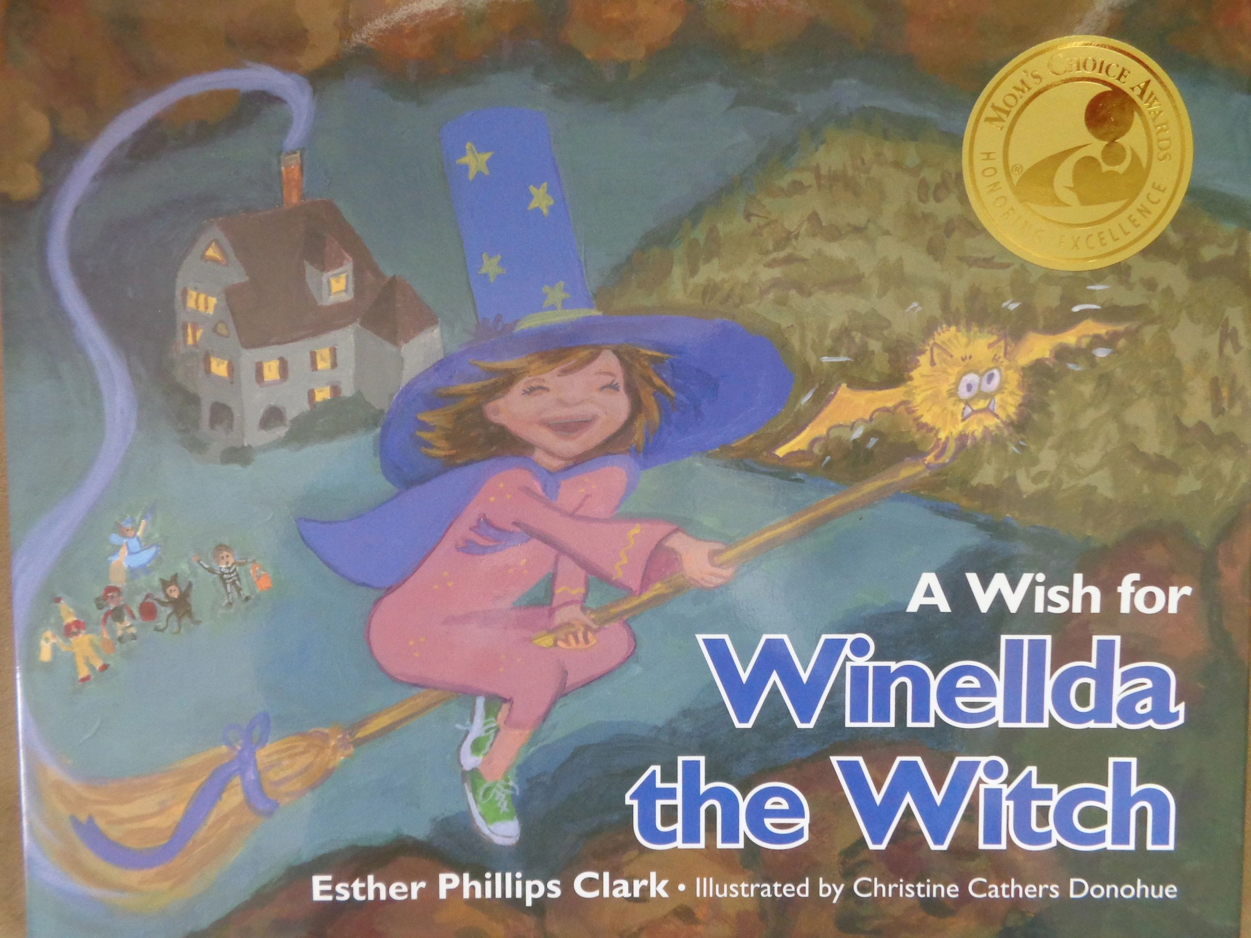 Meet Winellda WINELLDA is a witch of another kind. She's a stand out with her purple cape and flower
