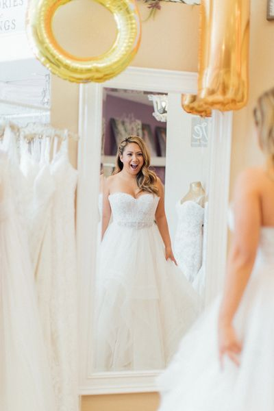 Bride wearing a wedding dress with excitement