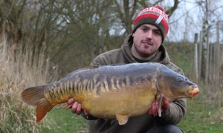 Carp fishing. Day ticket. Exclusive lake hire. Booking a lake. Cambridgeshire. Booking online.