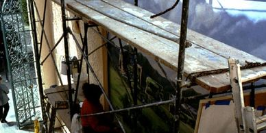 Scaffolding and artist Cecelia Davidson creating mural, Santa Monica. Photo by Eve Reynolds.
