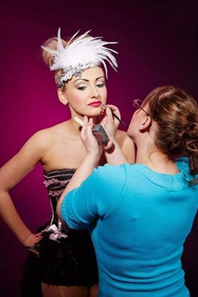 Action shot of Nikmakeup artist behind the scenes at a showgirl photoshoot. Used MAC cosmetics &Nars