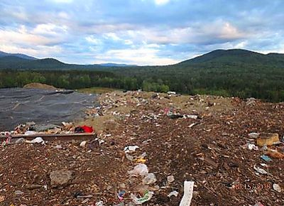 NH DES photo showing violation for inadequate ground cover at Casella landfill in Bethlehem, NH