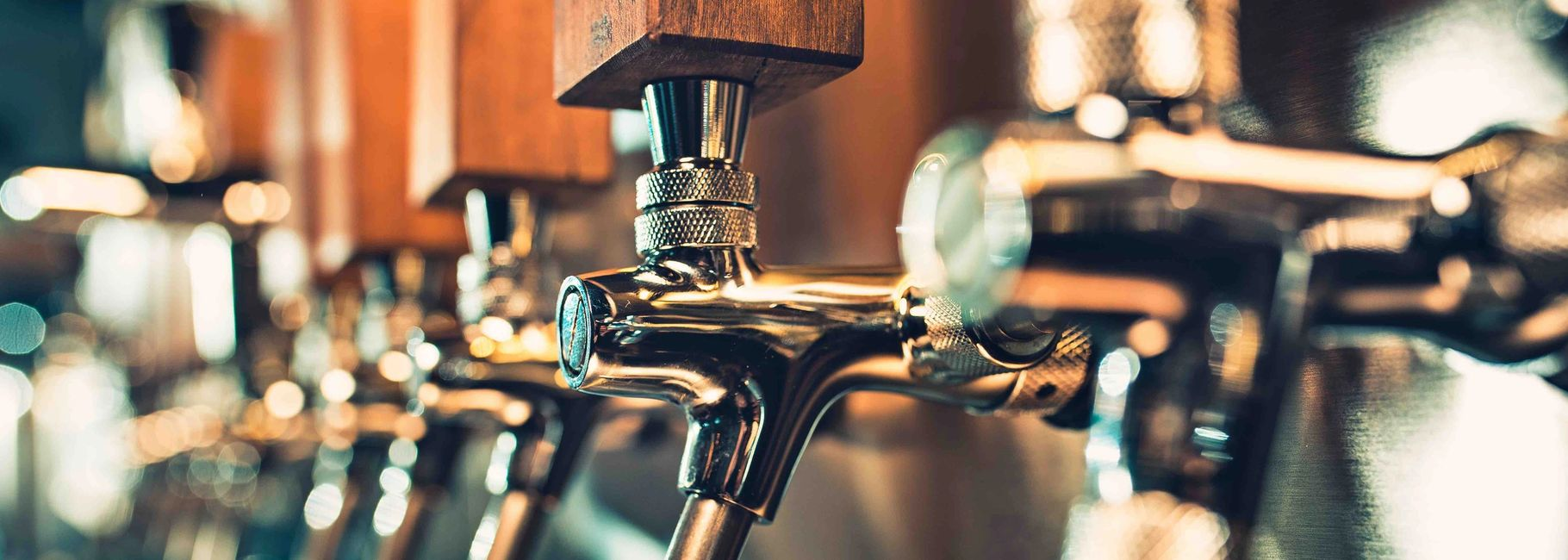 Craft beer taps.